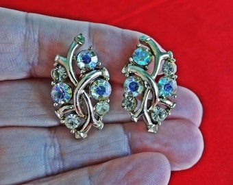 """STAR signed 1950s Vintage 1"""" gold tone clip earrings with aurora borealis coated rhinestones in great condition"""