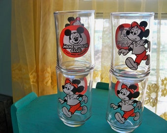 4 juice glasses of mickey mouse and the mickey mouse club