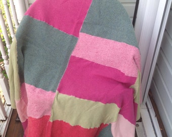 Handmade soft colorful pink and green wool patchwork throw blanket. Bedding. Sleep.