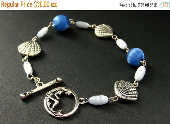 HOLIDAY SALE Mermaid Bracelet in Silver with Seashell Beads and Blue Silk. Handmade Bracelet.