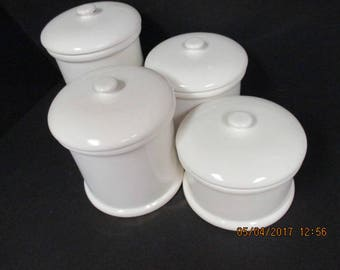 White Four Piece Canister Set