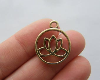 4 Lotus flower charms antique gold tone GC59