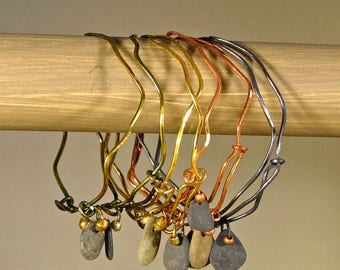 Adjustable, stackable bangle bracelets with Finger Lakes beach stones & vintage/recycled beads. Phosphor bronze or jeweler's brass.
