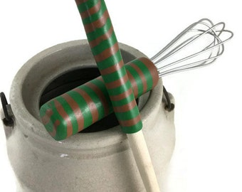Small whisk and spoon set for the cook green and brown handles