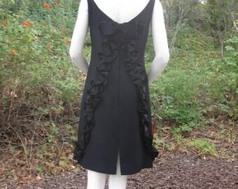 Audrey Hepburn LBD chic little black cocktail dress hi neck lo back sexy ruffles