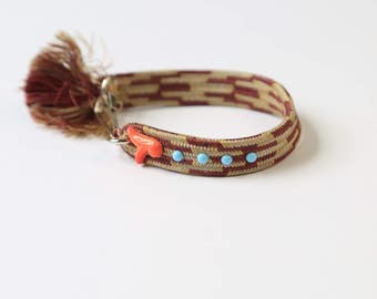 Gray and plum colored silk woven bracelet adorned with vintage cabochons