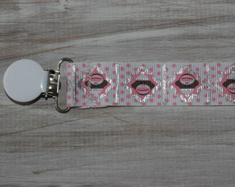 Baby girl pink sock monkey ribbon suspender binky clip