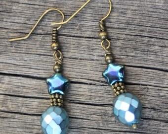 Aqua blue metallic star earrings