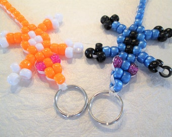 Set of 2 beaded lizard key chain/zipper pulls, 1 blue and black, 1 orange and white