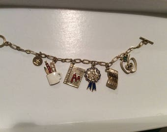 """Vintage LC Bracelet""""#1 Teacher  """"gold Tone with dangling  charms 1976 Mint signed"""