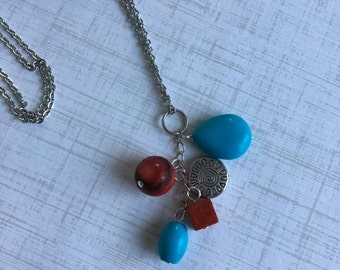 Turquoise and Red Coral Pendant Cluster w/Long chain and charm, stainless steel