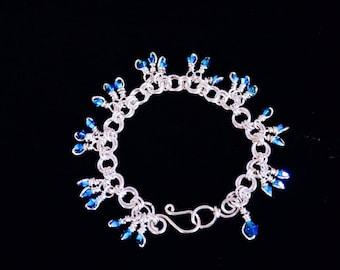 Silver Rosette Bracelet with Swarovski Crystals .