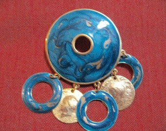 Turquoise enameled circle pin with dangling circles and rings