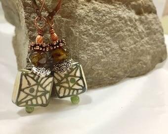 Lampwork glass dangle earrings with glass enameled headpins. Copper leverback ear wire!