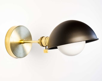 Brass sconce with black shade