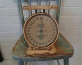 American Family Scale Measuring in Ounces.