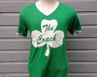 Distressed 1980's The Coach t-shirt, fits like a medium