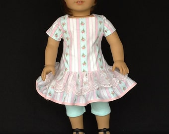 18 inch doll dress, hair clip, and leggings.  Fits American Girl Dolls.   Ruffled dress with lace trim.