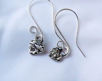 One of a Kind Fine Silver Tiny Heart Earrings. Textured tiny heart dangle earrings. Curled ear hooks added to the tiny hearts.