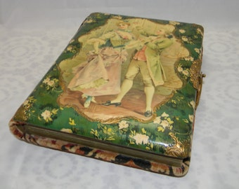 Antique Celluloid and Velvet photo album with photos 18th Century courting couple
