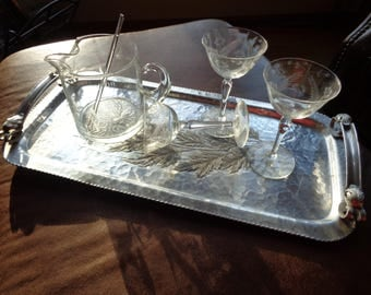 STIRRED, NOT SHAKEN, Retro Martini Pitcher with three etched crystal stemware glasses displayed on an old aluminum tray in Vintage Condition