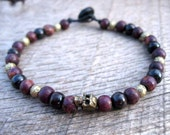 Mens tribal bracelet, tiny skull bead with brass and dyed bone beads on strong cord with a toggle and loop clasp, handmade and one of a kind