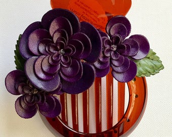 Leather Spring blossom flowers in bun holder on PURLE
