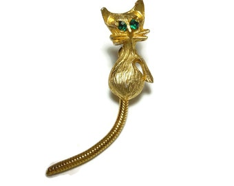Cat scatter pin, gold tone, green rhinestone eyes, moveable articulated tail, figural cat kitty kitten, mid century