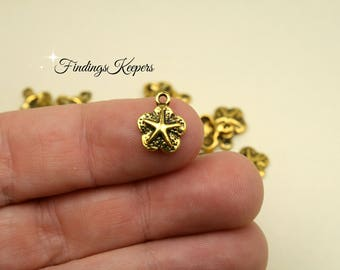3 Sand Dollar Charms Antique Gold Tone Metal 10 x 12 mm - cg269