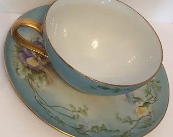 Vintage teacup and saucer handpainted