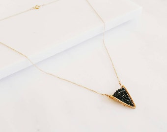 Handmade triangle shaped pendant corralled with black spinel gemstones