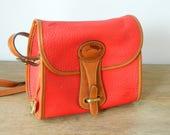 Vintage Dooney and Bourke red leather shoulder bag and wallet. crossbody. satchel. 1980's.