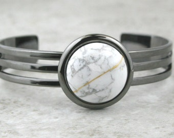 Kintsugi (kintsukuroi) cuff bracelet with white howlite stone cabochon with gold repair in a gunmetal black plated setting - OOAK