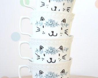 4  hand-printed happy cat faces cups