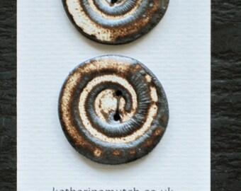 Pair of large handmade ceramic buttons - ammonite swirl. Brown cream. 37mm.