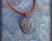 large Leo pendant necklace on thick black leather cord