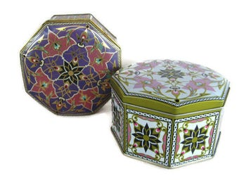 2 vintage tins with ornate arabesque designs and octagonal shapes
