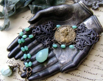 metal cameo asymmetrical assemblage bracelet with aqua chalcedony and lampwork blossom headpin, rosary style chain, filigree, AnvilArtifacts