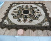 Doll House Rug, Square, 7 1/2 inches X 7 inch rectangle, It is Brown and Beige with Fancy Brown Trim, It is on a scale of 1:12