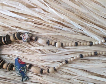 Hawaiian Wood beads 24 inch necklace and fish decoration.