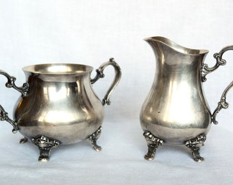 Vintage cream and sugar service…Gorham creamer and sugar bowl…yc1553 and yc1554.