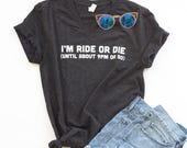 I'm Ride or Die Until About 9PM or So Unisex Adult Tee. Black vneck tee.