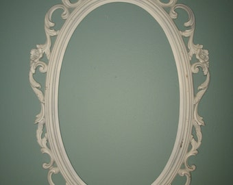 Oval frame baroque style molded polyresin. Framed wall mirror, wedding photo frame.
