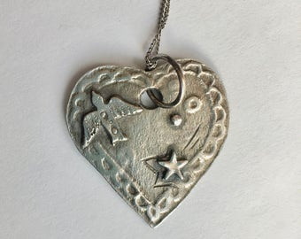 new heart with bird pendant necklace in sterling