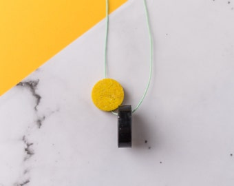Orbital statement necklace // Polymer clay disc necklace on jade green cotton cord