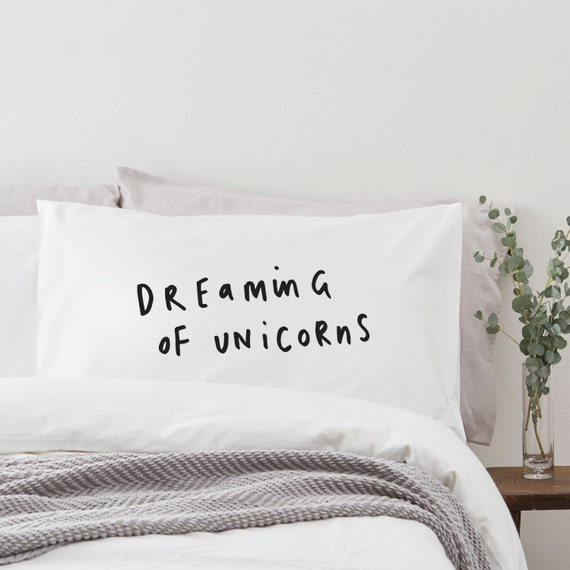 White pillowcase with black dreaming of unicorns print