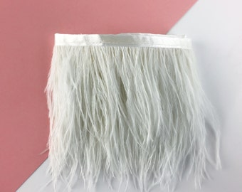 Ribbon of white ostrich feathers / sold by 30 cm Strip