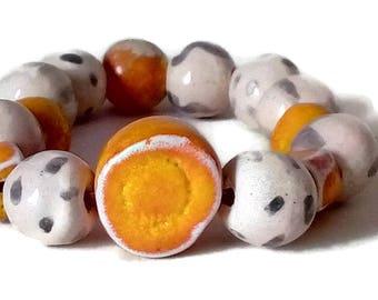 Ceramic beaded bracelet, handmade jewelry, unique women bracelet, orange bracelet, wired silicone extendible, bold bracelet, one of a kind