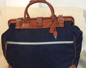 Genuine vintage FELISI navy canvas and leather duffle travel bag RARE