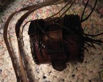 Vintage brown leather hippie purse box like fringed long shoulder strap.